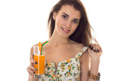Summertime close up portrait of young charming girl in light clothes with cocktail in hands posing isolated on white Royalty Free Stock Images