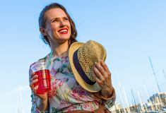 Traveller woman with bright red beverage Royalty Free Stock Images