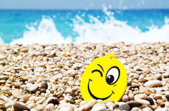 Summertime concept. Smiley on the beach as summertime concept Royalty Free Stock Photography