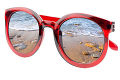 Summertime concept -  Sunglasses have a beach  wave of sea - iso. Summertime concept -  Sunglasses have a beach with wave of sea  reflecting on isolated white Stock Photography