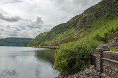 Summertime forests and mountain lake scenery in the Elan valley of Wales. Stock Image