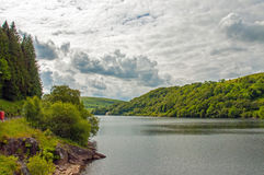 Summertime forests and mountain lake scenery in the Elan valley of Wales. Royalty Free Stock Photo