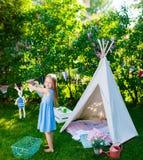 Summertime fun. Adorable little girl having fun playing outdoors on summer day Stock Photos