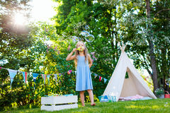 Summertime fun. Adorable little girl having fun playing outdoors on summer day stock photography