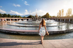 Summertime girl near fountain Stock Images