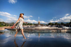 Summertime girl near fountain Royalty Free Stock Photos