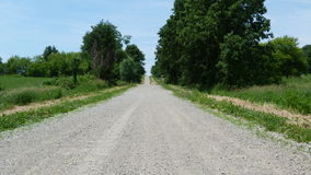 Summertime Gravel Road. This gravel road in the middle of Summer leads to somewhere. Discovery awaits royalty free stock photos
