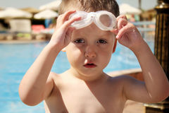 Summertime.  happy child playing in the water on the pool Royalty Free Stock Photography