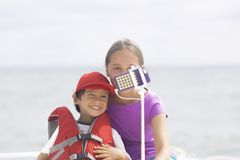 Summertime, Happy Girl and Boy Making Selfie Royalty Free Stock Photography
