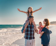 Summertime holidays. Family walkig the beach with children in summer royalty free stock photography