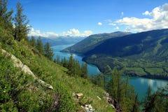 Summertime at Kanas Lake. Summer scenery of Kanas Lake, Xinjiang Province, China Royalty Free Stock Photo