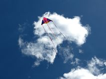 Summertime Kite. A brightly coloured kite soars up to the clouds on a summer's day royalty free stock photography