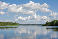 Summertime lake. Calm summer day clouds reflecting on a lake in rural Maine Royalty Free Stock Photos
