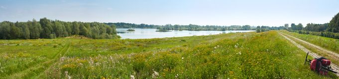 Summertime landscape banner, panorama - view of river valley of the Odra Оder, tourist bicycle route along the river Stock Image