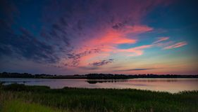 Summertime landscape with sunset over lake Royalty Free Stock Photography