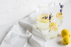 Summertime lemonade with lavender flowers in glasses and jar Royalty Free Stock Images