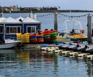 Summertime at the marina; kayaks, boats, jet skis Royalty Free Stock Photos