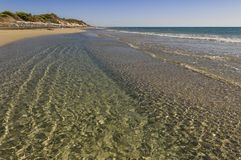 Summertime. The most beautiful sand beaches of Apulia: Alimini bay,Salento coast. Italy Lecce. It is a vast sandy coast protecte royalty free stock photography
