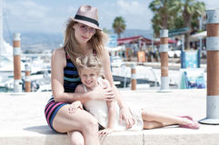 Summertime. Mother and doughter at Latchis harbour Stock Photo