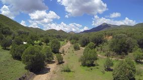 Summertime mountain valley aerial stock footage