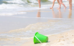 Summertime at the ocean. Sand pail on beach by children royalty free stock photos