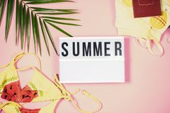 Summertime pastel colours flatlay. Top view summer vacation beach accessories on pink pastel background stock photo