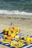 Summertime. A picnic on the beach. Burgers and pitas, vegetables. And fruits. Selective focus Stock Photo