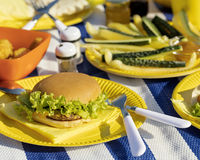 Summertime. A picnic on the beach. Burgers and pitas, vegetables. And fruits. Selective focus Stock Photos