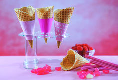 Summertime pink ice cream cones preparation. Royalty Free Stock Photos