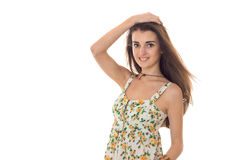 Summertime portrait of young charming girl in light clothes smiling on camera isolated  white background Royalty Free Stock Images