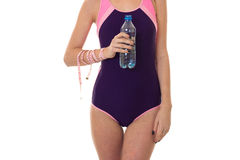 Summertime portrait of young sexual lady in full length swimsuit with bottle  water and measure tape isolated on whit Stock Images