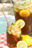 Summertime Refreshing Iced Tea Drink With Lemons. Refreshing iced tea drink in summertime with lemon Royalty Free Stock Photography