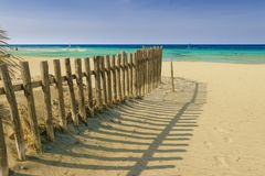 """Summertime.The Regional Natural Park Dune Costiere Torre Canne: fence between sea dunes. Apulia-ITALY-. The regional nature Park """"Dune Costiere da Torre royalty free stock photography"""