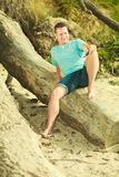 Handsome man relaxing on beach during summer. Royalty Free Stock Photo