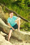 Handsome man relaxing on beach during summer. stock images