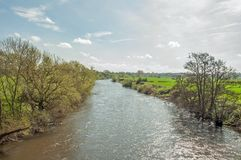 Springtime scenery along the River Wye in the English countryside. A summertime river scene along the Wye valley in the English countryside of Herefordshire in Royalty Free Stock Photo