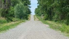 Summertime Road. Out in the middle of nowhere in the Summertime royalty free stock photo