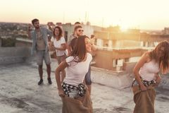 Summertime rooftop party sack race Royalty Free Stock Photos
