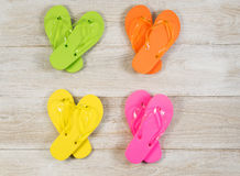 Summertime Sandals on Faded Wood Stock Photo