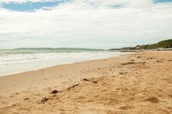 Summertime scenery on Bournemouth beach. A summertime scene along Bournemouth beach, Dorset, the United Kingdom Royalty Free Stock Photo