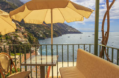 Summertime seascape. Amalfi coast: Positano beach Spiaggia Grande.Italy Campania.Panoramic view from the tables of a bar. Stock Photo