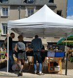 Summertime second hand street market in France. Second hand records for sale on stall under white canopied tent type dome at secondhand street market in france Royalty Free Stock Images
