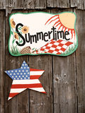 Summertime sign on barn wall. This stock picture shows a wooden Summertime sign on a barn wall Royalty Free Stock Photography
