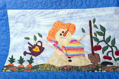 Summertime Snowman quilt Stock Photo
