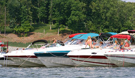 Summertime Social. Boats tied together for a summer social on the lake Stock Photos