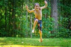 Summertime sprinkler fun Royalty Free Stock Photography