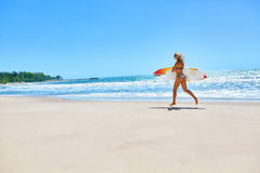 Summertime. Surfing. Summer Sport. Woman With Surfboard Running Royalty Free Stock Photo