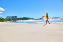 Summertime. Surfing. Summer Sport. Woman With Surfboard Running Royalty Free Stock Image