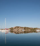 Summertime on swedish coast. Scenic view of a small cove with sail boats and motor boats Royalty Free Stock Image