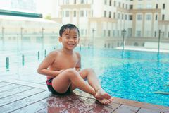 Summertime and swimming activities for happy children on the poo. L royalty free stock photo